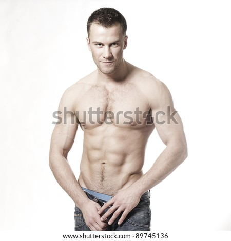Sexy muscular macho man smiling isolated on white - stock photo