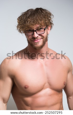 Sexy muscular male model wearing in glasses