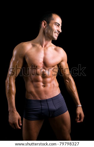 Sexy muscular man against black background - stock photo