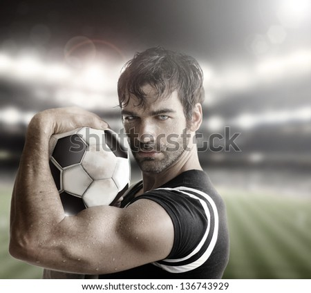 Sexy muscular man athlete with ball - stock photo