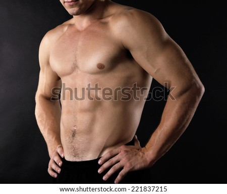 Sexy muscular man on dark background