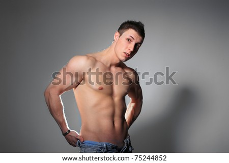 Sexy muscular man over gray background