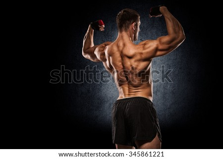 Sexy muscular man  with clipping path on dark background - stock photo