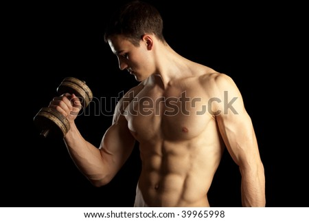 Sexy Muscular Man with Dumbells - stock photo