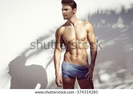 Sexy muscular model posing  - stock photo