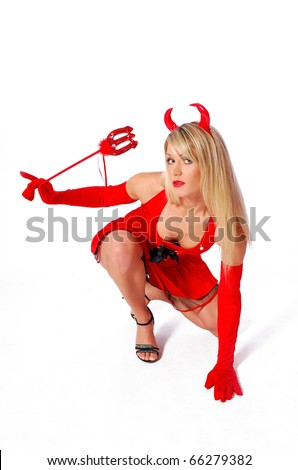 Sexy, mysterious devil girl is lurking - stock photo
