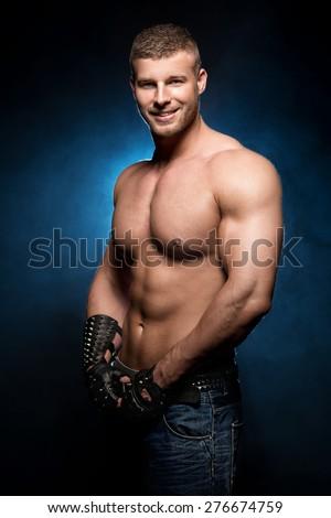 Sexy naked man posing in studio - stock photo