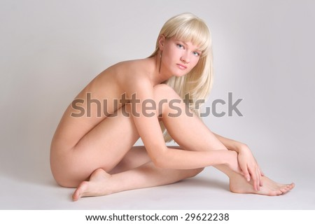 sexy naked woman on grey background