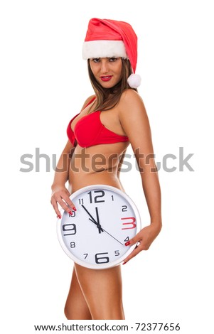 sexy naked woman with santa hat posing with clock - isolated on white - stock photo