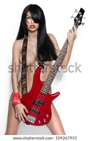 sexy nude girl  with a guitar. Fashion-art foto. Other photos from this series in a portfolio - stock photo