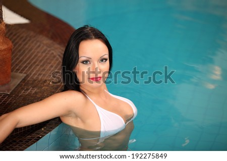 Sexy nudes beautiful caucasian woman in the jacuzzi. or pool Flirtatious look on the face.  - stock photo