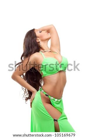 Sexy oriental dancer in green suit - stock photo