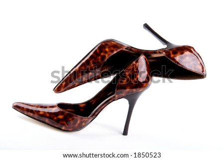 sexy pair of high heels carefully balanced on one another - stock photo