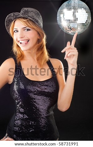 Sexy party girl enjoying with disco ball