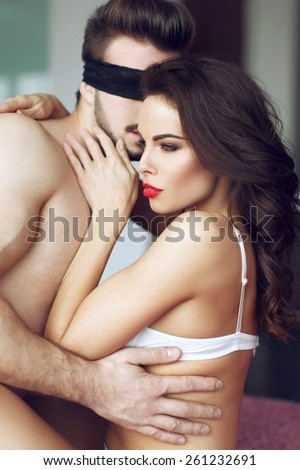 Sexy passionate couple foreplay at home - stock photo