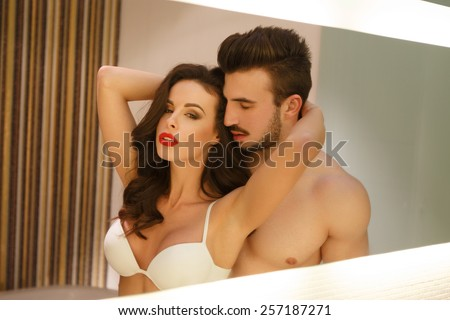 Sexy passionate couple posing at mirror, young lover - stock photo