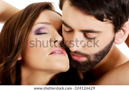 Sexy passionate heterosexual couple embracing.