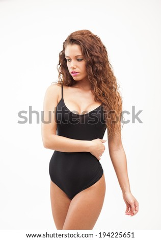 Sexy perfect brunette woman in black body on white isolated background