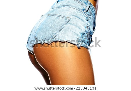 Sexy perfect female woman buttocks sunbathed ass  in jeans shorts isolated on white - stock photo