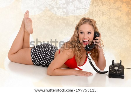 Sexy pin up girl talking on a phone