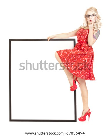 Sexy pinup girl with a blank presentation board - stock photo