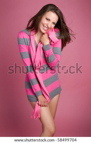 Sexy playful woman wearing pink - stock photo