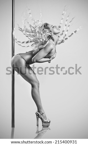 Sexy pole dancer - stock photo