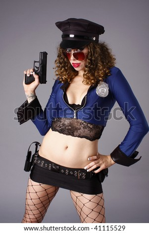 Sexy police woman with guns.