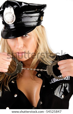 Sexy policewoman holding manacles - stock photo