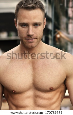 Sexy portrait of a confident muscular young man - stock photo