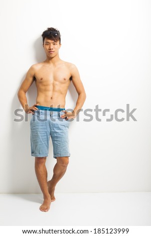 Sexy portrait of a muscular shirtless male model  - stock photo