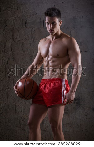 Sexy portrait of a very muscular male model in sensual pose. Fashion colors. Collage. - stock photo
