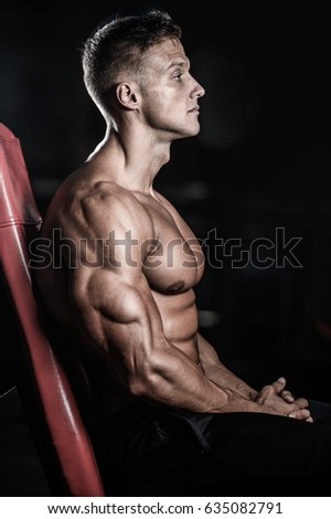 Sexy portrait of a very muscular shirtless male model looking away