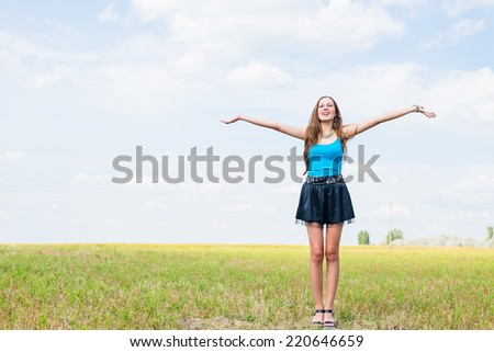 sexy pretty girl in mini skirt jumping high and happy smiling on blue sky outdoors copy space background portrait - stock photo