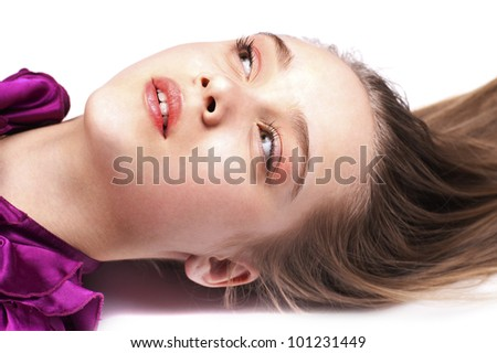 Sexy pretty woman lying on the floor, close up, looking up, in pink dress - stock photo