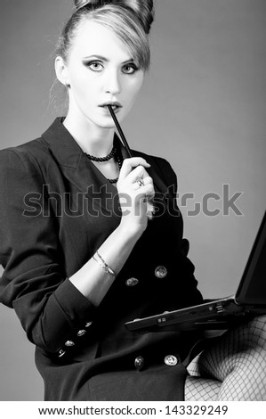 sexy provocative business woman at office with laptop