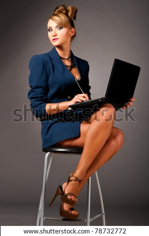 Easiest way to Find Ladies – Locate a Friend within a Big City stock photo sexy provocative business woman at office with laptop 78732772