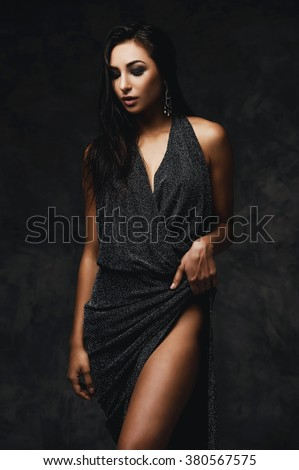 sexy raven haired indian lady posing seductively in front of camera