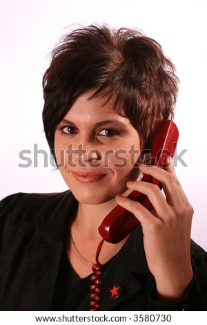 Sexy receptionist on telephone smiling and looking at the camera isolated on white