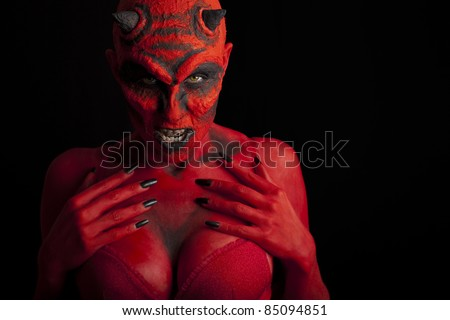 Sexy red devil woman, black background. - stock photo