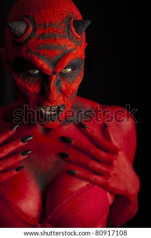 Sexy red devil woman, Low key lighting.
