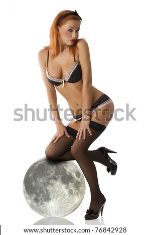 sexy redhead pin-up in black lingerie and black stocking