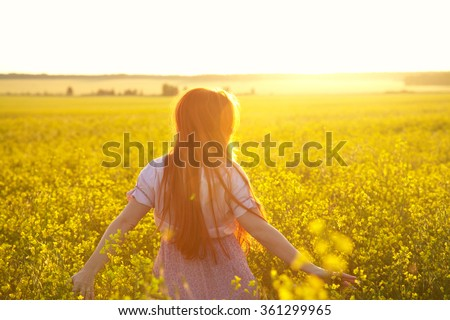 sexy redhead woman in a dress outdoors. Beautiful stylish romantic young girl on nature background. yellow field - stock photo
