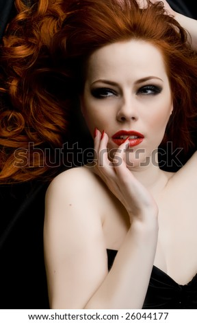 Sexy redhead young woman - stock photo