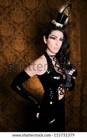 Sexy Retro Cabaret - Glamorous Vixen with Gothic Glass - stock photo