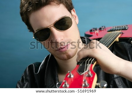 sexy rock man sunglasses and leather black jacket over blue - stock photo