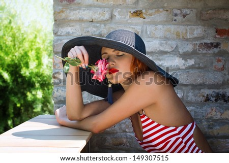 Sexy romantic woman in hat smell flower, outdoor - stock photo