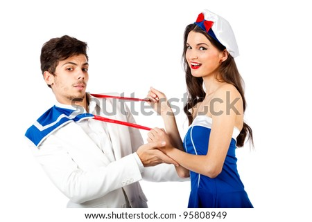 Sexy sailor woman seducing young elegant man. Isolated on white background. High resolution studio image - stock photo