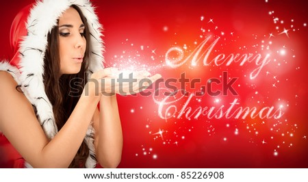 """sexy santa girl blowing magical """"Merry Christmas"""" text - stock photo"""