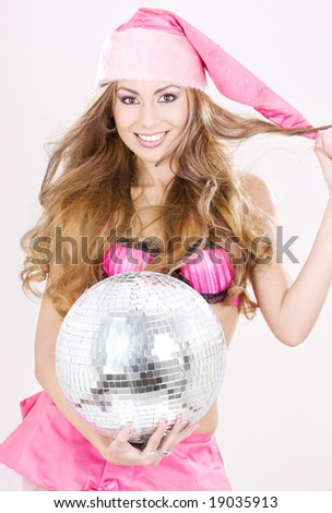 sexy santa helper in pink lingerie with disco ball - stock photo